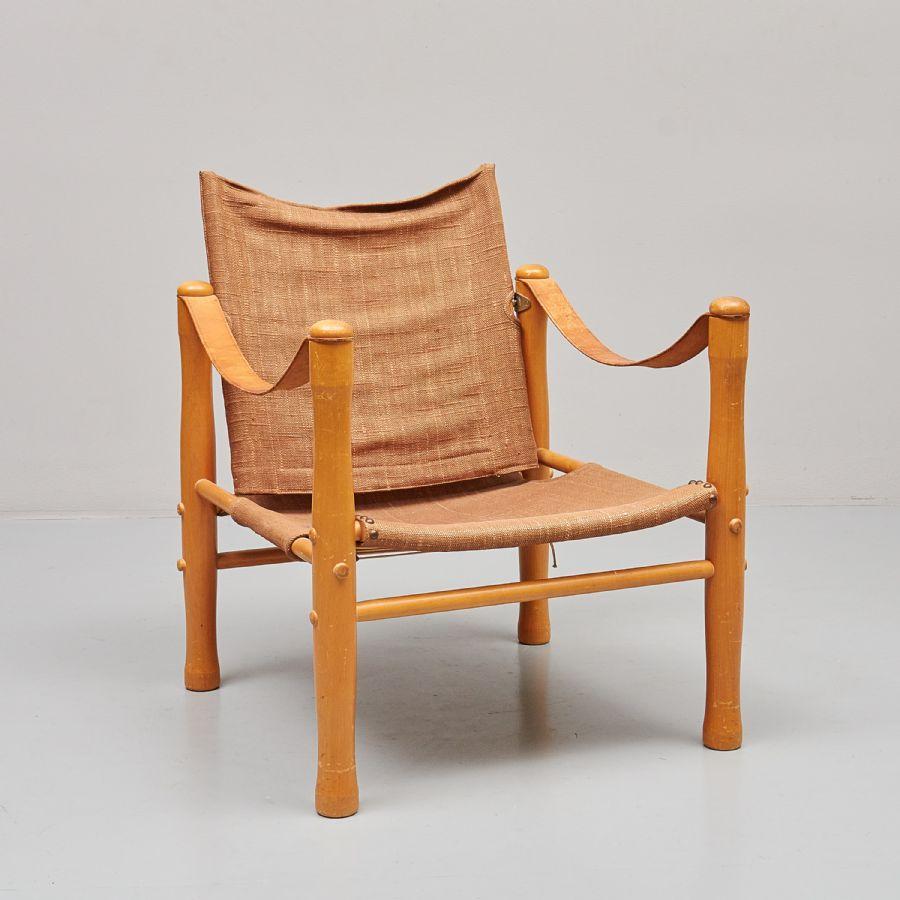 Fåtölj, Safarimodell, canvas skinn trä, slitage Metropol Auktioner i Stockholm och på